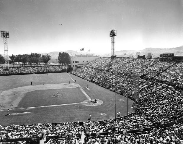The San Francisco Giants play the Los Angeles Dodgers during opening game of the first Giants game at Seals Stadium in San Francisco, Ca., April 15, 1958.  The Giants defeated the Dodgers, 8-0, and set an attendance record for the stadium with 23,192 fans.  (AP Photo)