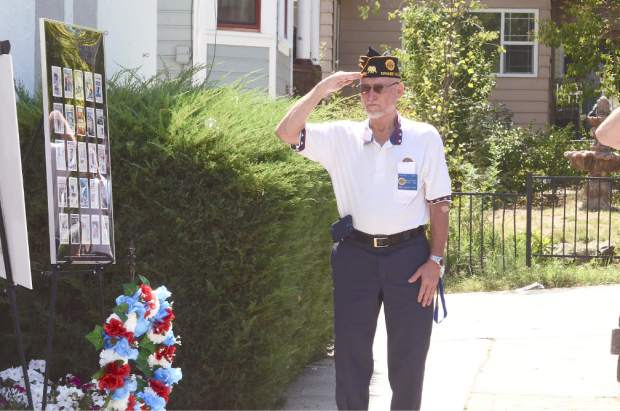 """David Cox salutes as """"Taps"""" plays during a  9/11 tribute Thursday at Grass Valley Veterans Hall on South Auburn Street."""