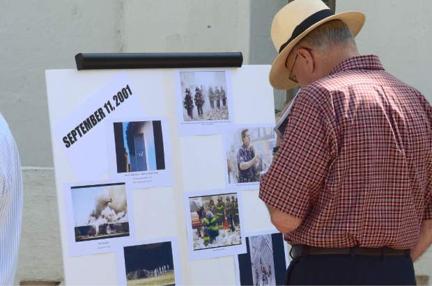Nevada County Supervisor Nate Beeson looks at a display of  9/11 disaster photos.