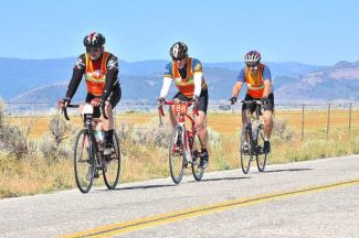 Cyclists ride in the The 31st Agony Ride in the Sierra Valley last year. Left to right are Dave Robinson, Ed Townsend, and Ken Sorensen.