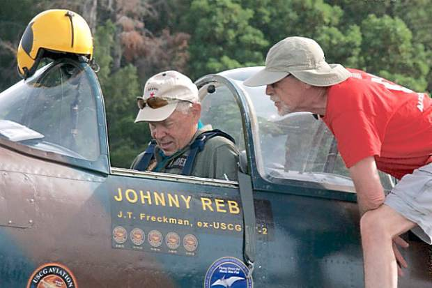 Philip Vardara (on the right) talks to pilot and owner John Freckman of the Nanchang CJ-6 plane. The plane was made in China and Freckman was a People's Liberation Army Air Force basic trainer. The Nevada County Airport  hosted a Fly-in and Open House Saturday.