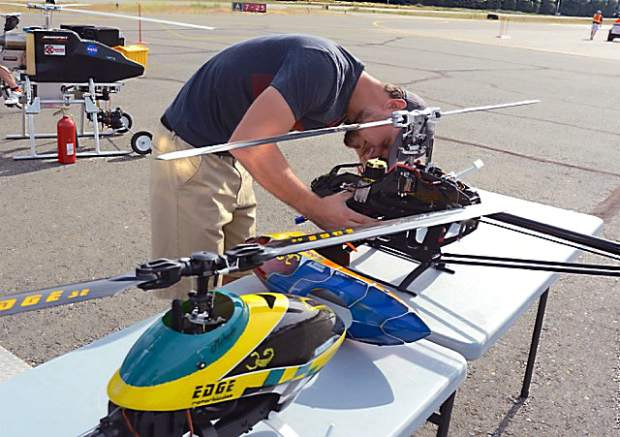Jesse Kavros works on a radio control helicopter. The Nevada County Airport  hosted a Fly-in and Open House Saturday.