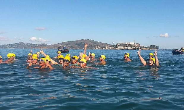 American Indian swimmers from South Dakota, Washington and California celebrating the completion of the Alcatraz Island to the South End Rowing Club, Aquatic Park, San Francisco, crossing Monday.