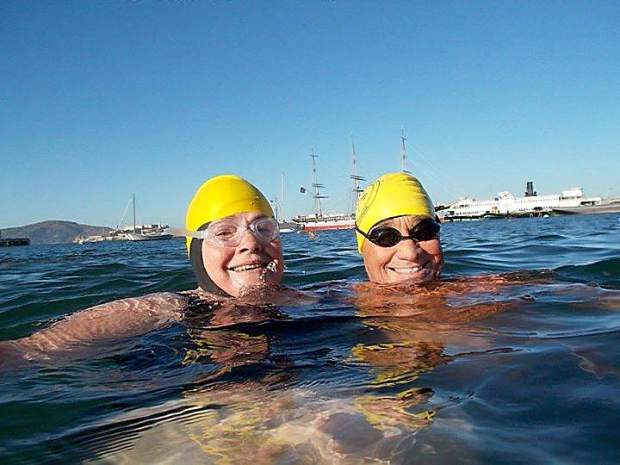 Patricia Smith and Randy Brown, a South End Rowing Club support swimmer, practice in Aquatic Park, San Francisco.