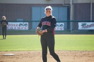 Bear River alumna Maddie Phelps readies to fire a pitch for Sierra College during a game.