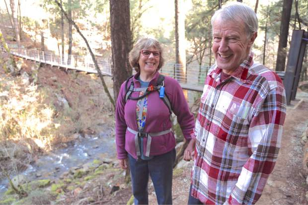 Cathy Anderson-Meyers and Geno Meyers pause for a break during a recent hike. Geno Meyers has been diagnosed with early onset of Alzheimer's disease, but thanks to support of his teammates that has not deterred the lifelong runner from earning All-America status last year.