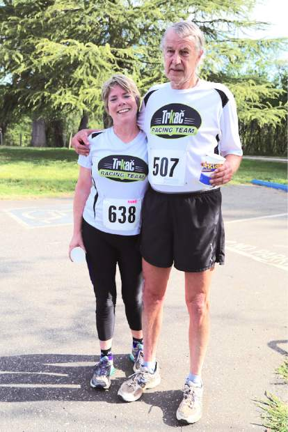 Geno Meyers poses for a photo with  teammate Anne King, who ran alongside him in Sunday's Daffodil Run in Penn Valley.