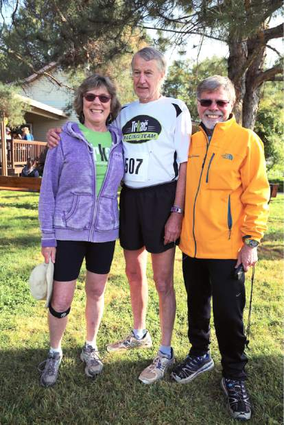 Cathy Anderson-Meyers, Geno Meyers, and Trkac coach Clyde Lehman pose for a photo prior to Sunday's Daffodil Run in Penn Valley.