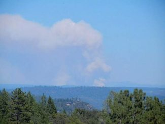 The American Fire emits a plume of smoke on Monday afternoon visible from Interstate 80 about a half hour or so west of Truckee.