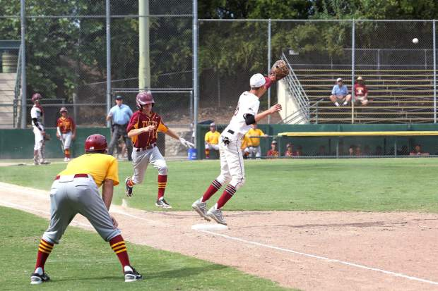 Bear River's Jacob Van Patten forces the runner off first during a playoff game against Los Banos Wednesday afternoon.