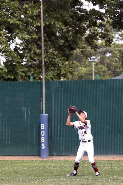 Bear River's Will Last catches a pop fly during a playoff game against Los Banos Wednesday afternoon.