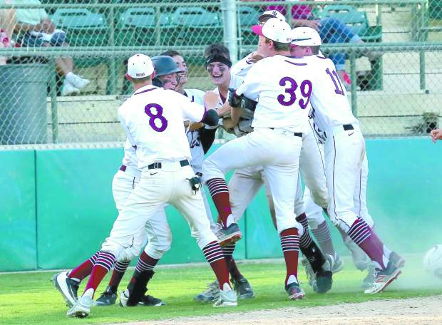 Bear River's Jake Rodgers celebrates a walk-off home run with his teammates to finish off their playoff game against Los Banos Wednesday afternoon.