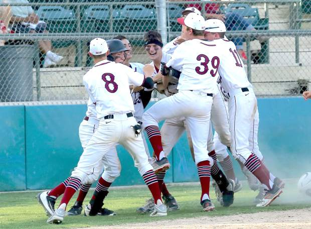 Bear River's Jake Rogers celebrates a walk-off home run with his teammates to finish off their playoff game against Los Banos Wednesday afternoon.