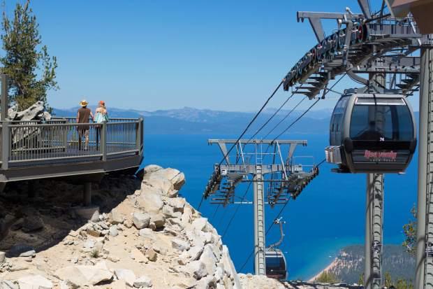 Visitors tour Heavenly's mid-mountain viewing platform. Summer traffic has risen in mountain towns accross the west over three years with resorts and tourism boards placing a greater emphasis on year-round activities.