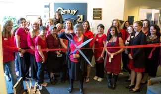 Joan Lehman, broker of Century 21 Davis Reality, is pictured cutting red ribbon from the Tapestry Network of Nevada County's first ribbon-cutting ceremony Wednesday at Century 21, Davis Realty. The Tapestry Network is providing free ribbon cutting ceremonies for each of its members, and Century 21 Davis is celebrating 40 years of business in Nevada County.