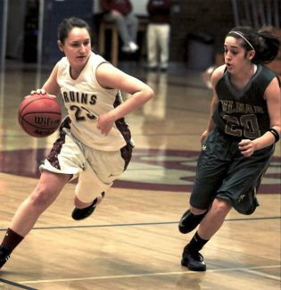Bear River's Savannah Welz dribbles past her defender during a Sac-Joaquin Section Division IV playoff game against Himar Tuesday night at Jack R. McCrory Gymnasium.