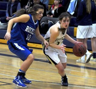 Nevada Union's Nicole Lierly drives past a defender during an early season matchup with Siera Foothil League foe Rocklin.