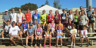 Bear River 5K age group winners pose together after the 2013 race.
