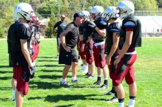 Assistant coach Duane Zauner gives a few pointers during a Bear River football practice.