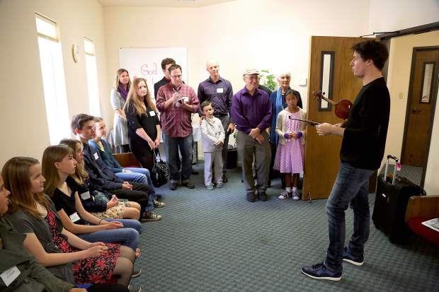 Joshua Bell talks to local kids before his performance at the Seventh-day Adventist Church in Grass Valley Sunday.