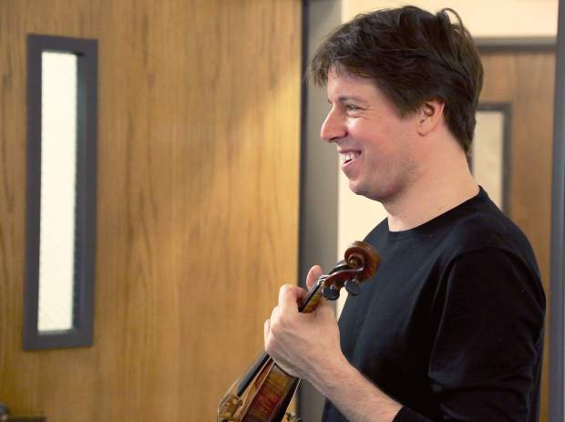 Joshua Bell talks to local kids before performing at the Seventh-day Adventist Church in Grass Valley Sunday.