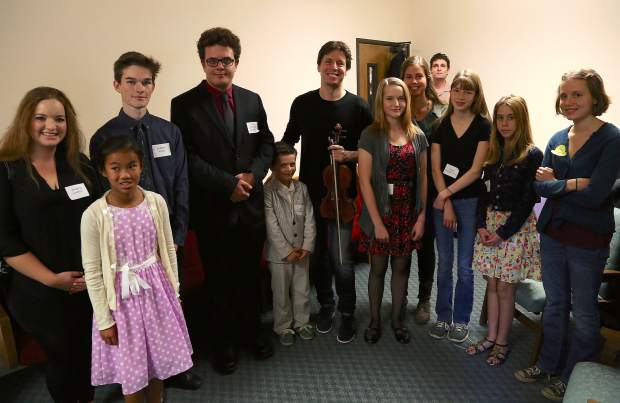 Joshua Bell with local kids before his performance at the Seventh-day Adventist Church in Grass Valley Sunday.