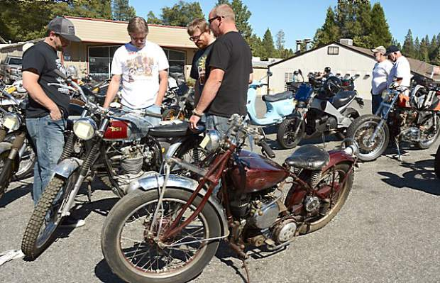 A group checks out the old BSA bike at ol' Republic Brewery. New and old American, Japanese, British and European bikes were on display at the inaugrual Bikes & Beer Show Saturday.