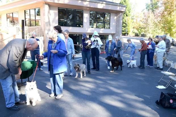 People line up for theBlessing of the Animals, Saturdayat Peace Lutheran Church in Grass Valley.