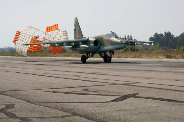 A Su-25 jet lands after a combat mission at Hemeimeem airbase, Syria, on Thursday, Oct. 22, 2015. Since early morning, Russian combat jets have been taking off from this base in western Syria, heading for missions. (AP Photo/Vladimir Isachenkov)