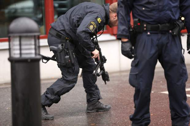 Police officers secure the area after a masked man attacked people with a sword, at the Kronan school in Trollhattan, Sweden, Thursday Oct. 22, 2015. At least six people were injured, and the offender was shot by the police. (Bjorn Larsson Rosvall / TT via AP) SWEDEN OUT