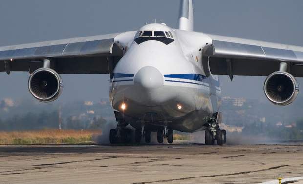 ALTERNATIVE CROP OF MOSB112 - A Russian aircraft lands at Hemeimeem airbase, Syria, on Thursday, Oct. 22, 2015. Since early morning, Russian combat jets have been taking off from this base in western Syria, heading for missions. (AP Photo/Vladimir Isachenkov)