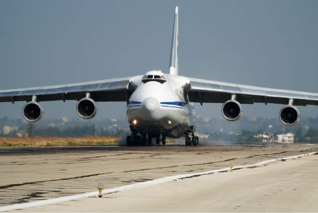 A Russian aircraft lands at Hemeimeem airbase, Syria, on Thursday, Oct. 22, 2015. Since early morning, Russian combat jets have been taking off from this base in western Syria, heading for missions. (AP Photo/Vladimir Isachenkov)