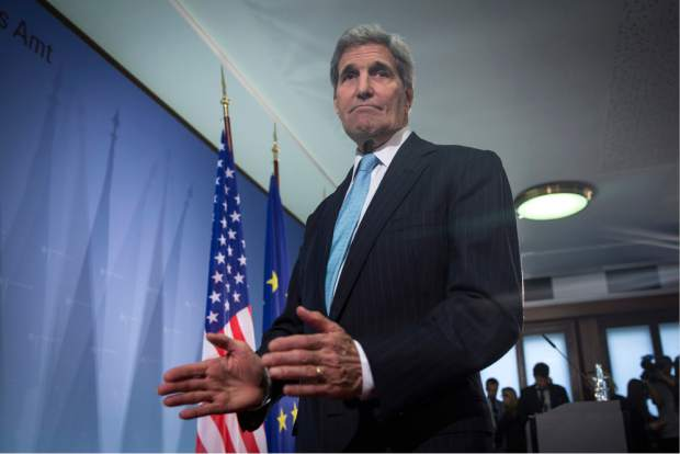 United States Secretary of State John Kerry departs following a press briefing with Germany's Foreign Minister Frank-Walter Steinmeier in Berlin, Thursday Oct. 22, 2015.   Secretary of State John Kerry says the U.S., Iran, Russia and Europe agree Syria should be united and that Syrians should choose their own future leadership.  (Carlo Allegri / Pool via AP)