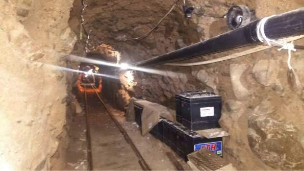 This Wednesday, Oct. 21, 2015 photo released by Mexico's Federal Police shows an underground tunnel that police say was built to smuggle drugs from Tijuana, Mexico to San Diego in the United States. Mexican federal police said the tunnel extends about 2,600 feet (800 meters) and is lit, ventilated, equipped with a rail car system, and lined with metal beams to prevent collapse. (Mexico Federal Police via AP)