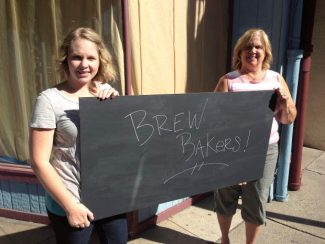"Britni McKinney, left, stands with her mothe,r Robin Spencer, in front of their new cafe,""Brew Bakers Family Cafe."