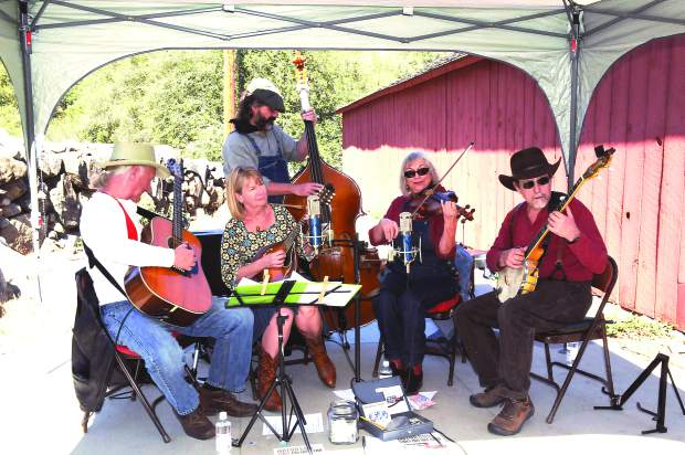 the South Yuba River Park Association and the South Yuba River State Park invite you to the Bridgeport Fall Festival at the South Yuba River State Park, Pleasant Valley Road. The Buffalo Gals performing the old times American music at the festival, left to right are: Jonathan Meredith, Ann Meigs, Philip Wright, Margo Meredith, and Michael Bremer.