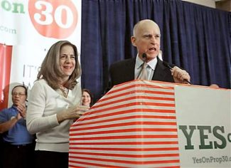 "FILE - In this Nov. 6, 2012 file photo, Gov. Jerry Brown and his wife, Anne Gust Brown thank supporters for their work on his temporary tax hike initiative, Proposition 30, during an election night party in Sacramento, Calif. The 74-year-old governor is being treated with radiation for early stage prostate cancer, his office announced Wednesday, Dec. 12, 2012. Brown's ""prognosis is excellent, and there are not expected to be any significant side effects,"" University of California, San Francisco oncologist Eric Small said. (AP Photo/Rich Pedroncelli, File)"