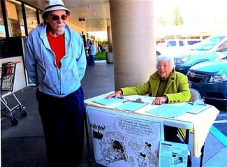 R.L. Crabb, cartoonist for The Union, and Virginia Brunini man a table Saturday to collect signatures for a petition to keep Empire Mine open as a state park. A California State Senate subcommittee recently voted to consider selling the park due to an annual $5 million expenditure by the Department of Parks and Recreation to operate the park. A substantial portion of that cost goes for remediation efforts to eliminate toxic run-off from the mining operation last conducted more than 50 years ago. Brunini said that the effort to collect signatures for the petition will continue until April 28.