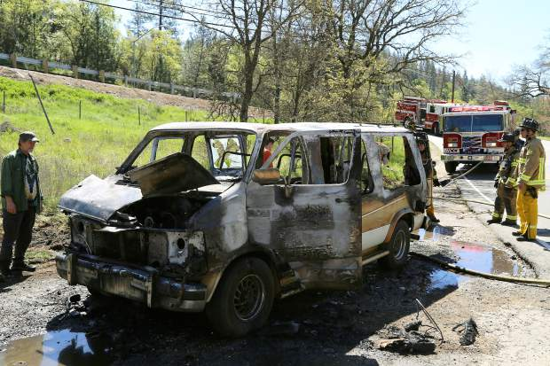 Vehicle fire contained at Old Auburn Road and Highway 49 Tuesday.