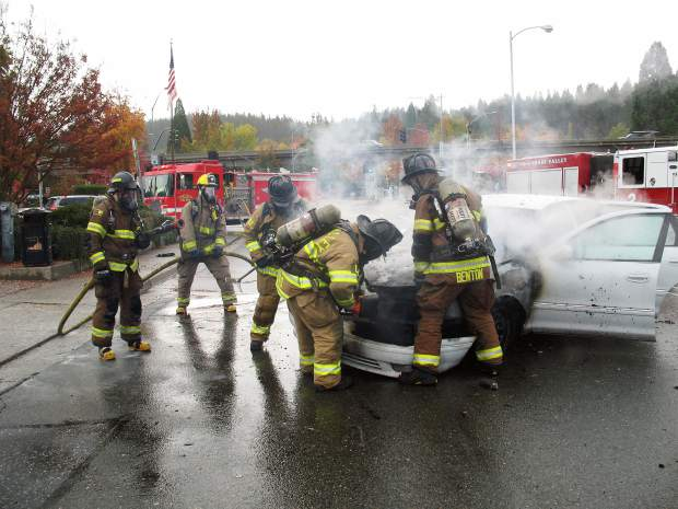 Grass Valley firefighters extinguishing the fire.