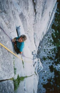 Phil Carville, in his 60s, scales the northwest face of Half Dome at Yosemite.