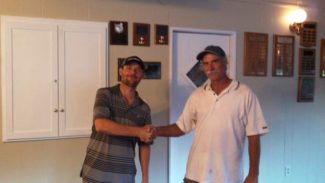 """""""Golfaholics"""" team members Bobby Blackmon and Dan Neff shake hands after winning the Nevada County Country Club's Summer Tuesday Night Golf League title."""