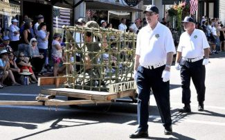 Nevada City celebrates 47th annual Constitution Day parade, Sunday afternoon down Broad Street. The Vietnam Vets POW in the cage. The Vietnam Veterans of America Chapter 535 won third place in the Best Float category.