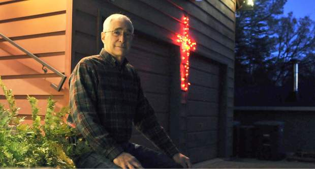 Christian spirit of Christmas with lighted cross in Lake Wildwood