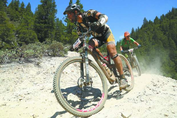Mountain bikers participate in the Downieville Classic on Saturday. The race and festival celebrates its 20th anniversary this weekend in Downieville.