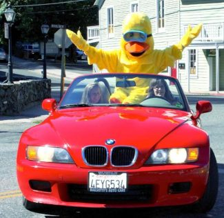 49er Rotary Duck Race mascot Whitewater Willie arrives via red convertible at last year's event.