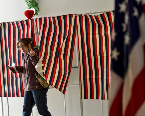 Shelley Coombs, from Hinsdale, N.H., casting her ballot at the Hinsdale, N.H. polling station during the New Hampshire primary on Tuesday, Feb. 9, 2016. (Kristopher Radder/The Brattleboro Reformer via AP)