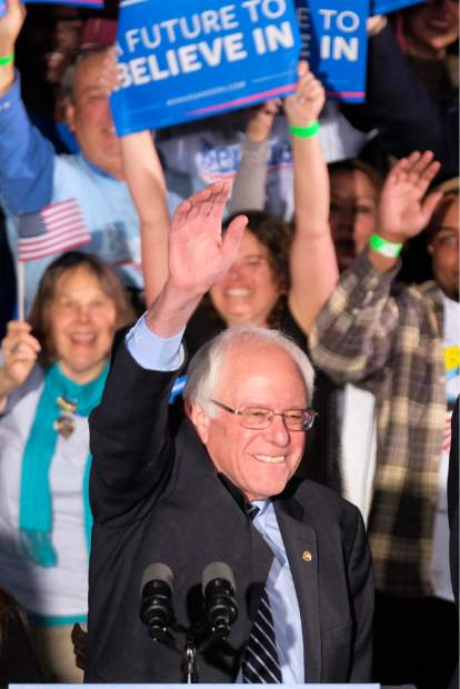 Democratic presidential candidate, Sen. Bernie Sanders, I-Vt., waves to the crowd at his primary night rally Tuesday, Feb. 9, 2016, in Manchester, N.H. (AP Photo/J. David Ake)