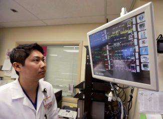 In this Monday, Jan. 14, 2013 photo, Dr. Steve Sun looks over a heart monitor display in the emergency room at St. Mary's Medical Center in San Francisco. A new government report shows the number of people seeking emergency treatment after consuming energy drinks has doubled nationwide over the last four years, the same period in which the supercharged industry has surged in popularity in convenience stores, bars and on college campuses. Sun said he had seen an increase in energy-drink related cases at the Catholic hospital where he works on the edge of San Francisco's Golden Gate Park. (AP Photo/Eric Risberg)
