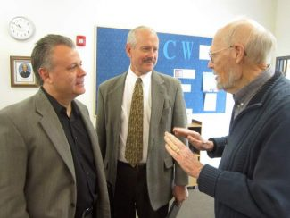 """Nevada County Chief Probation Officer Michael Ertola, left, and Sheriff Keith Royal, center, chat with Peace Lutheran Church member Bob Lenhard after a session of the Contemporary Issues Study Group. The group is considering """"Issues Facing Our Local Officials,"""" and meets at 9:15 a.m. Wednesdays at the church, 828 W. Main St., Grass Valley."""